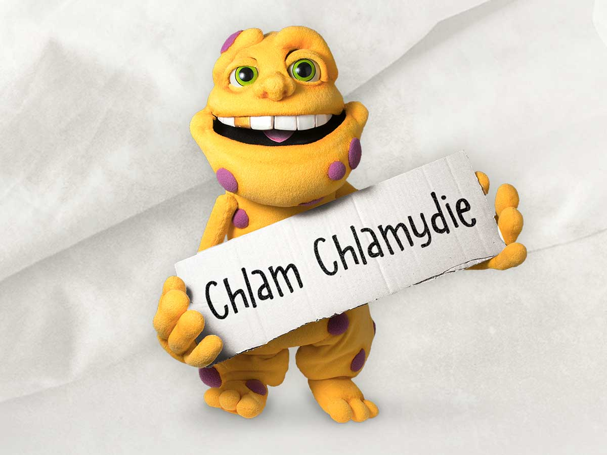 Image of the character Chlam Chlamydie holding up a sign with his name.