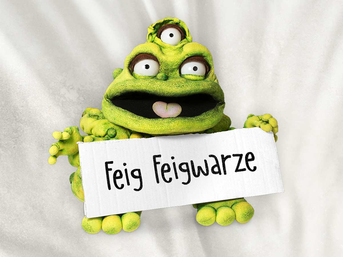 Image of the character Feig Feigwarze (genital warts) holding up a sign with his name.