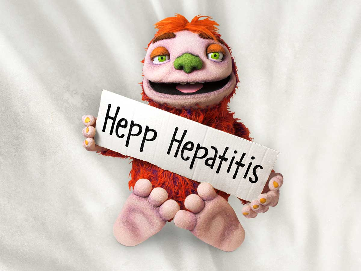 Image of the character Hepp Hepatitis holding up a sign with his name.