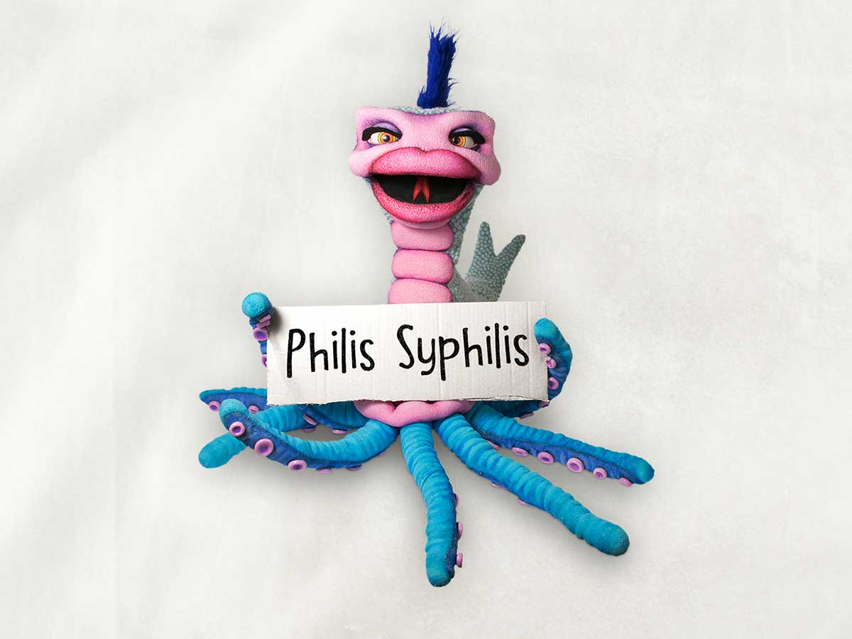 Image of the character Philis Syphilis holding up a sign with her name.