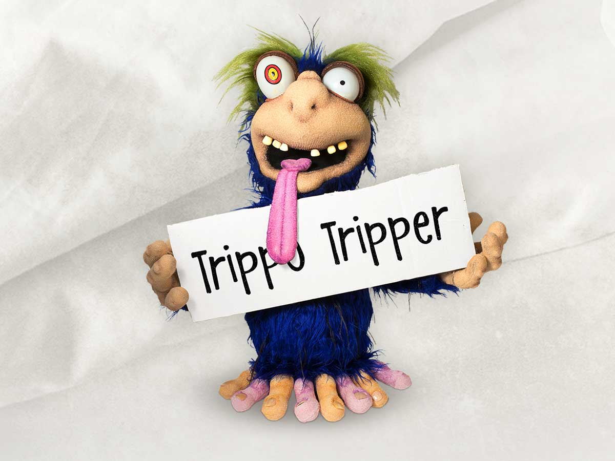 Image of the character Trippo Tripper (gonorrhoea) holding up a sign with his name.